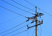 Electric pole with wires, blue sky. poster
