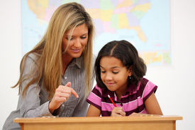 stock photo of student teacher  - Teacher and Student In A Classroom At School - JPG