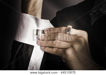 Man Putting Stylish Cuff Links On His Shirt