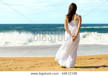 Woman On Beach Looking The Sea