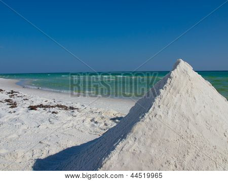Pyramid of white sand on the ocean