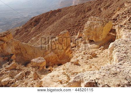 Scenic orange rocks in desert canyon (Small Crater or Makhtesh Katan in Negev desert Israel)