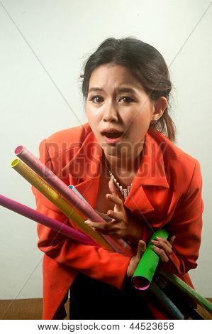 Busy Business Woman With A Lot Of Colorful  Papers On White Background .
