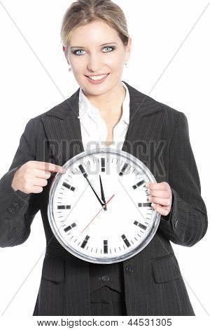 Smiling Businesswoman Holding A Clock