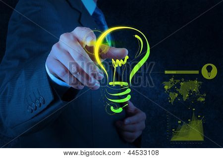 Businessman Hand Drawing Light Bulb On Touch Screen Computer