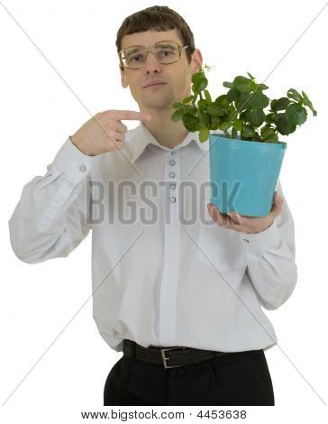 Man In Spectacles Showing On Window Plant