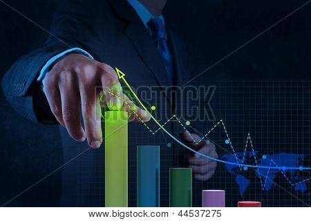 Businessman Hand Working With Virtual Chart Business On Touch Screen Computer