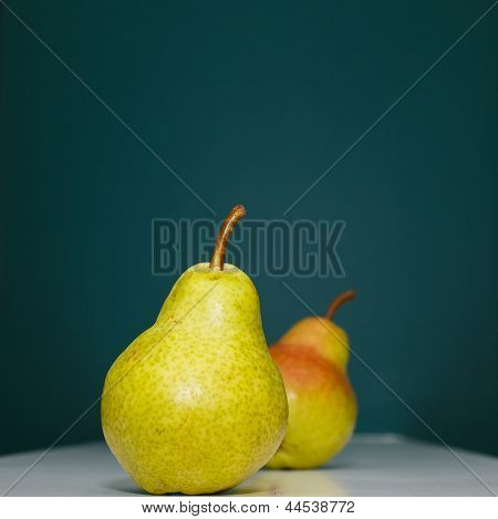 Two Pears On Green Background