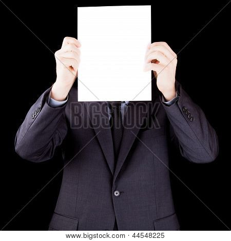 Businessman Holding  A Sheet Of Paper In Front Of His Face