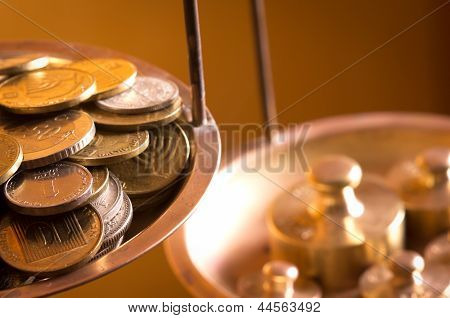 Coins On A Scale Weight