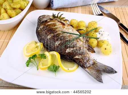 Grilled Fish With Potatoes, Sauce And Lemon