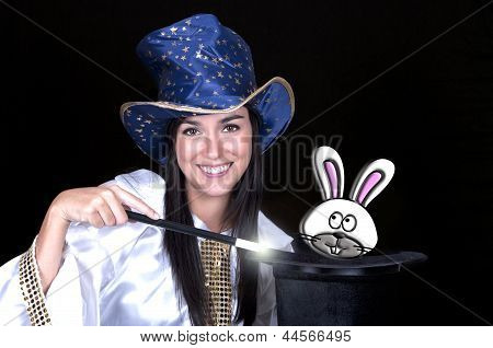 Attractive Woman With A Magic Wand And Hat