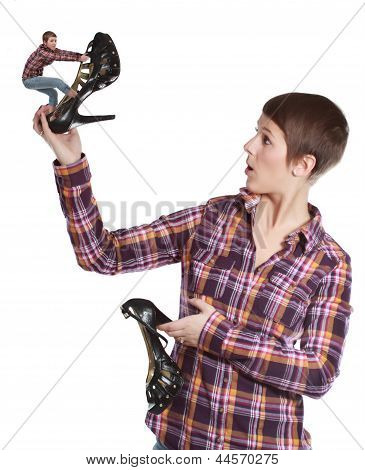Woman Holding A Shoe Climbed By A Tiny Girl