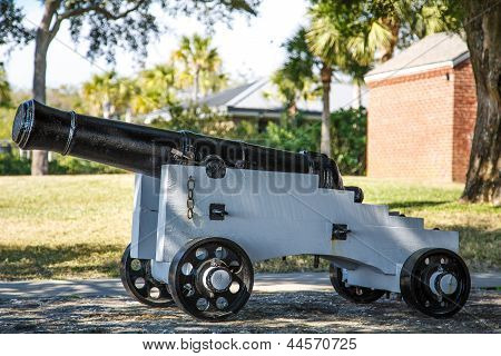 Old Black Cannon On White Wood Cart