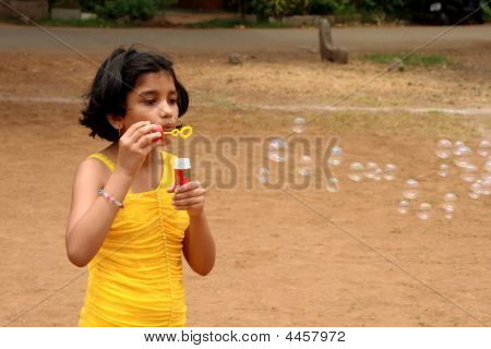 Girl Releasing The Soap Bubbles