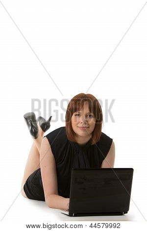 Woman Using Her Laptop On The Floor