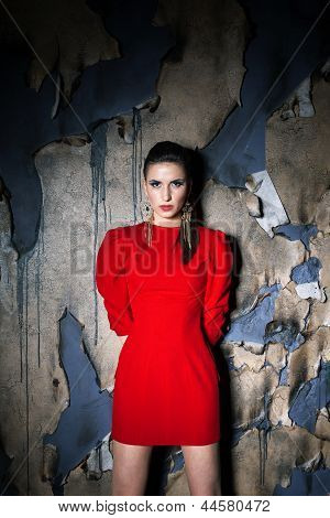Girl In Red Over Burned Background
