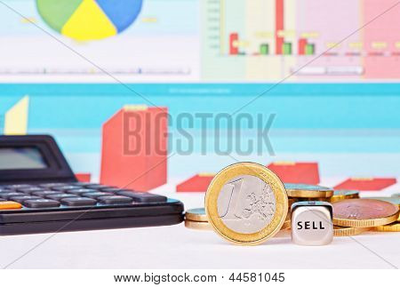 Dices Cube With The Word  Sell, One-euro Coin, Calculator  And Financial Diagrams As Background. Sel