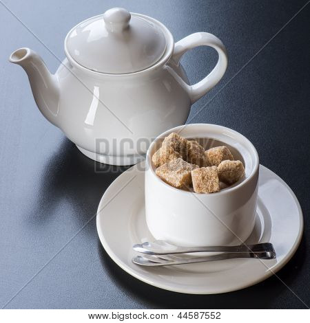 white tiapot with sugar bowl