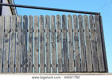 Wooden fence against the sky