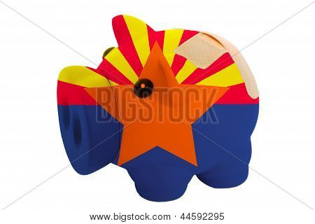 Closed Piggy Rich Bank With Bandage In Colors Flag Of American State Of Arizona
