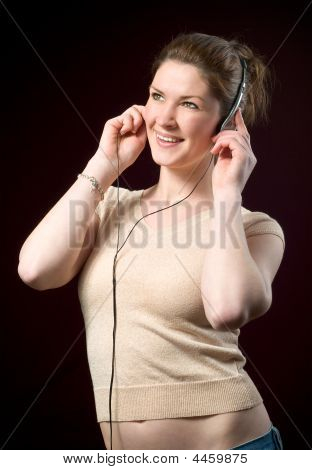Beautiful Smiling Girl Wearing Music Headphones