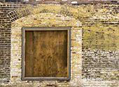 stock photo of character traits  - A old exterior brick wall with an old boarded up window ready for your content - JPG