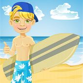 Cute teen boy with a surfboard on a sunny beach