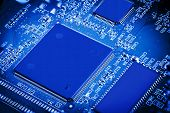pic of microchips  - Close up detail of blue microchip circuit board - JPG