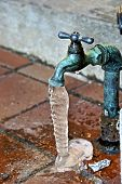 picture of spigot  - outside water spigot dripping and froxen with lots of ice