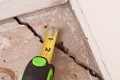 stock photo of foundation  - large deep crack in concrete foundation of house - JPG