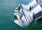 stock photo of outboard engine  - outboard engine on my boat in a harbour - JPG