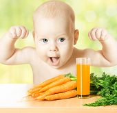 foto of root vegetables  - Child and fresh carrot juice glass - JPG