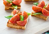 image of snow peas  - Bruschetta with fresh tomato and snow peas selective focus - JPG