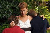 picture of grieving  - Mother comforting her sons  - JPG