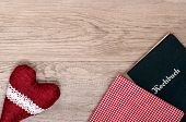 stock photo of bordure  - Red heart with checkered cloth and book on old wood - JPG