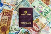 picture of colombian currency  - Colombian passport with various Latin American currencies