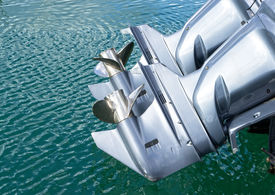 pic of outboard engine  - outboard engine on my boat in a harbour - JPG