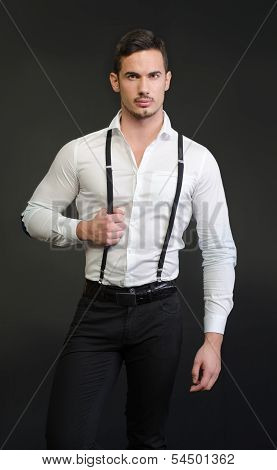 Elegant Young Man With White Shirt And Suspenders, Serious Expression