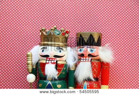 two nutcrackers on polka dots