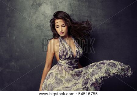 beautiful young  woman in an elegant dress studio shot