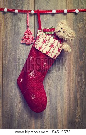 Christmas stocking filled with teddy bear with vintage feel