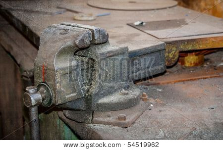 Old Vise On A Table