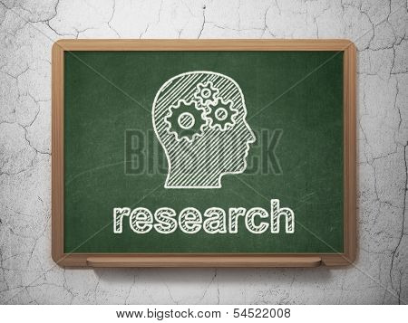 Marketing concept: Head With Gears and Research on chalkboard