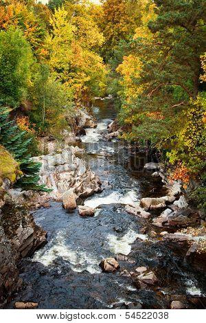 Dee river cascades during autumn season, Scotland, UK.