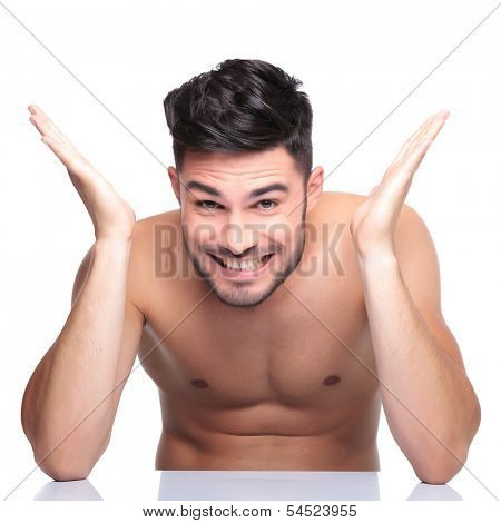 excited young man with no clothes on screaming of joy on white background