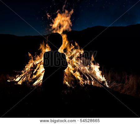 Silhouette of Boy by Bonfire