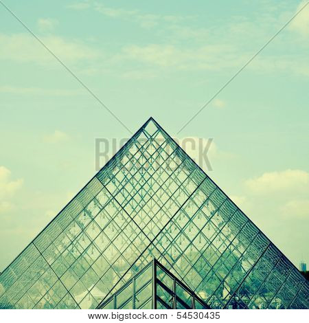 PARIS, FRANCE- MAY 17: Detail of the large glass pyramid of the Louvre Museum on May 17, 2013. The Louvre Museum is one of the largest museums of the world