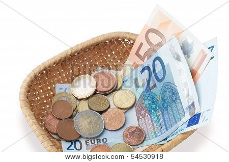 Basket With Coins And Banknotes