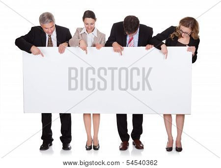 Businesspeople Holding A Blank Banner